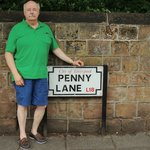 Standing next to Penny Lane Sign