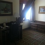 View of room from bed. Nice desk and area to set luggage.