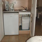 Stale kitchen units next to the bed in Room 1 - very romantic!