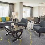 Regency Suites feature dining area with table for six, wet bar, Murphy Bed, and an extra half ba