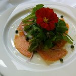 Smoked Salmon Carpaccio. Shaved Parmigiano-Reggiano, fresh mixed greens with a house made lemon