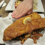 One-piece Cod and Chips - fries are hiding under the gigantic piece of fish!