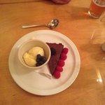 The delicious flour-less chocolate tart with vanilla ice cream