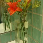 vases of flowers in the ladies toilets