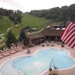 Outdoor pool with the slopes & alpine slide in the background