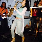Glendys Monica funky sax player playing live at Ize