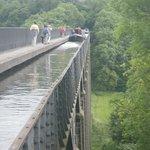 View of narrowboat traversing aqueduct