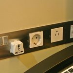Only 1 international outlet available by the desk. We added our own international plug adapter.