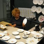 Skilled lady painter specialized in dinner plates