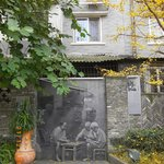Pictures of olden China line the walls of some alleys.