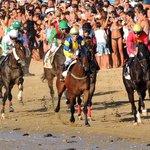 La carreras de caballos.