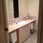 The bathroom joins 2 bathrooms