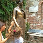 Bronze statue whose right breast gets groped by tourists in photos