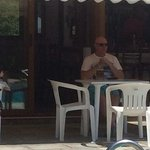 Pavlos deep in thought enjoying nice glass of ice cold Mythos