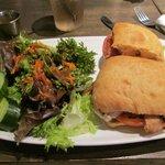 My grilled chicken sandwich with salad.