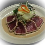 Tuna Tataki appetizer. Seared Ahi tuna with sesame soy vinaigrette.