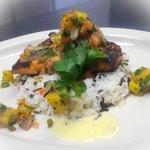 Fresh grilled salmon with sesame-orange glaze, jasmine rice pilaf and roasted pineapple salsa.