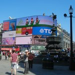 Vid screens, red buses and the Angel of Christian Charity