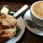 Fruit scone and flat white coffee.