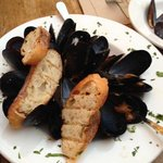 The mussels are fresh and delicious. You can ask for more bread when you run out to dip in the d