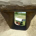 View of the wagon through a hole in the wall