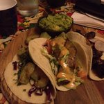 Zesty prawn, seasoned snapper and carnitas soft shell tacos with a side of guacamole