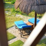 You can lay out on these beach chairs below your room