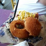 chili dog with giant, hand sized onion rings