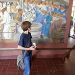 Our grandson in front of one of the wonderful paintings of Coit Tower
