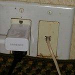 Outlet under bedside table