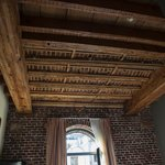 the wooden ceiling and the outer brick wall in our room
