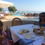 Kids having Breakfast on the Beach side