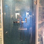 Powerful shower-shame it doesn't drain well!