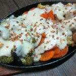 Grilled veggies with creamy white sauce.