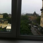 Taras Shevchenko's monumet is behind the trees.The center of Lviv from my room in Coffee Home Ho