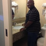 my husband is modeling the bathroom space
