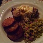 Beef tenderloin, covered with seared scallops and crabmeat. Fried green tomatoes limas and andou