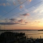 From the deck of the Penzance room, sunset over Great Harbor.