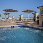 Enjoy the outdoor pool overlooking the beach