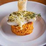 Feta crusted fillet of hake with edamame, sun blushed tomato & chorizo risotto