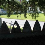 Standing behind the fence on top of the grassy knoll looking towards assisination