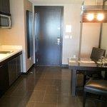 Doorway to corridor, plus kitchen area