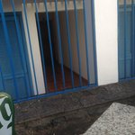 Room 304 from bar, entrance door is behind iron bars, bedroom window is on right