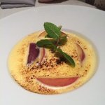 peach flambe with mint and creme brulee