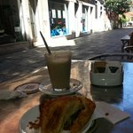 """Cafe next to """"Lavanderia"""" laundromat.  Pleasant chance  enjoy a Latte and pastry while launderin"""
