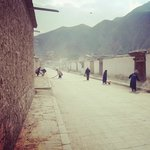 Women sweeping the road leading to the Monastery.