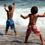 Grand kids frolicking in sea foam
