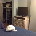 TV in bedroom. Notice the towels on the bed- they were folded to look like turtles!