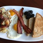 the farmer's table with local eggs, housemade bacon and smash browns