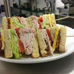 the katz club with local fried egg, roast turkey, bacon, lettuce and tomato